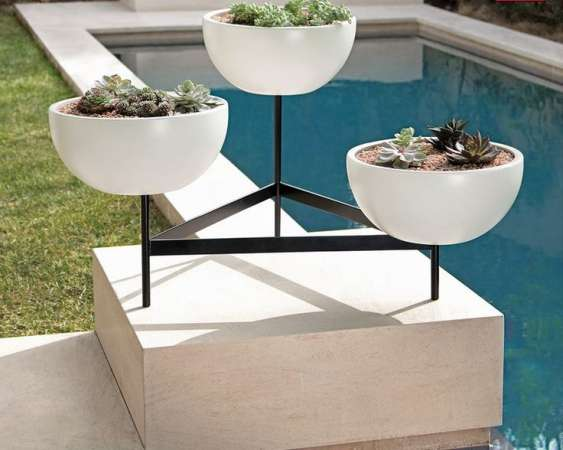 http://www.digsdigs.com/37-modern-planters-to-make-your-outdoors-stylish/pictures/86863/