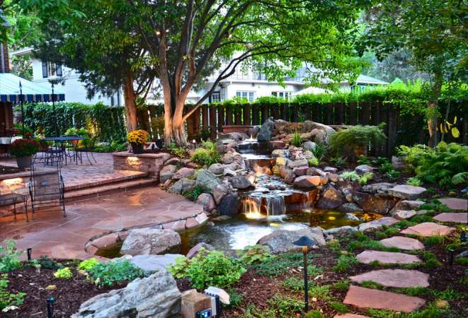 http://www.digsdigs.com/63-relaxing-garden-and-backyard-waterfalls/pictures/103221/