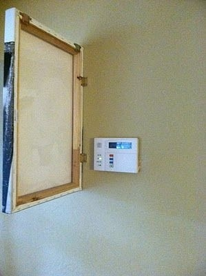 http://www.thethirdboob.com/2012/01/diy-photo-canvas-alarm-panel-cover.html?showComment=1325975185156