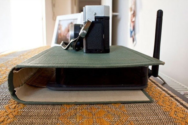 http://www.apartmenttherapy.com/how-to-make-a-book-cover-disguise-for-your-wireless-router-171857