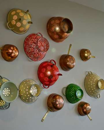 http://www.recyclart.org/2013/11/colander-wall-lights/