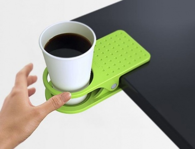http://odditymall.com/clip-on-table-cup-holder